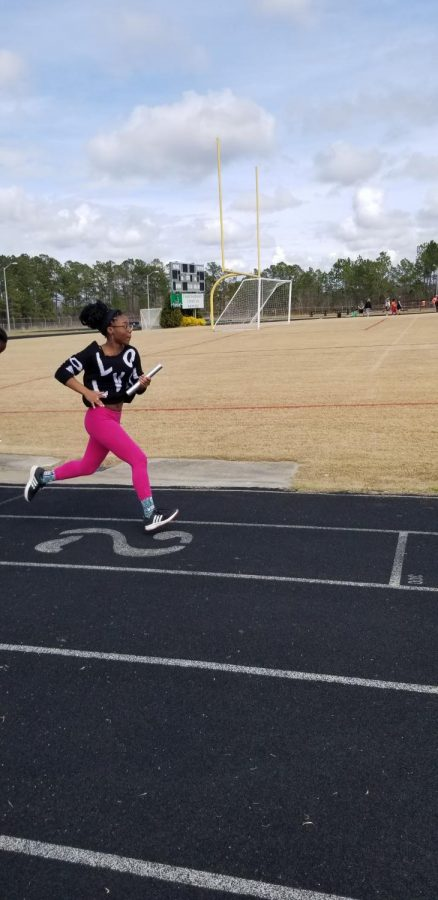 Katana Bland as she practices for 4x100 relay.
