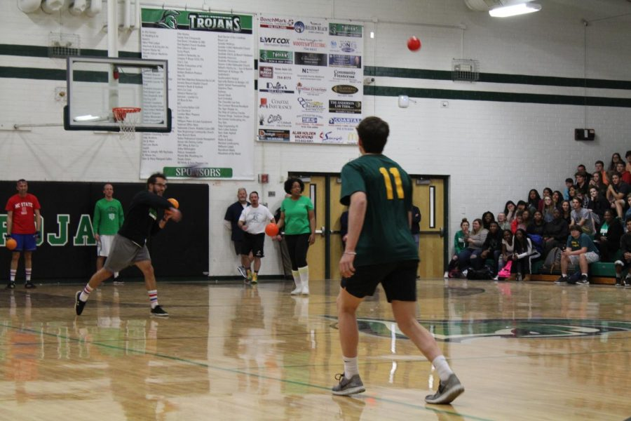 Students  facing staff in a dodgeball game.