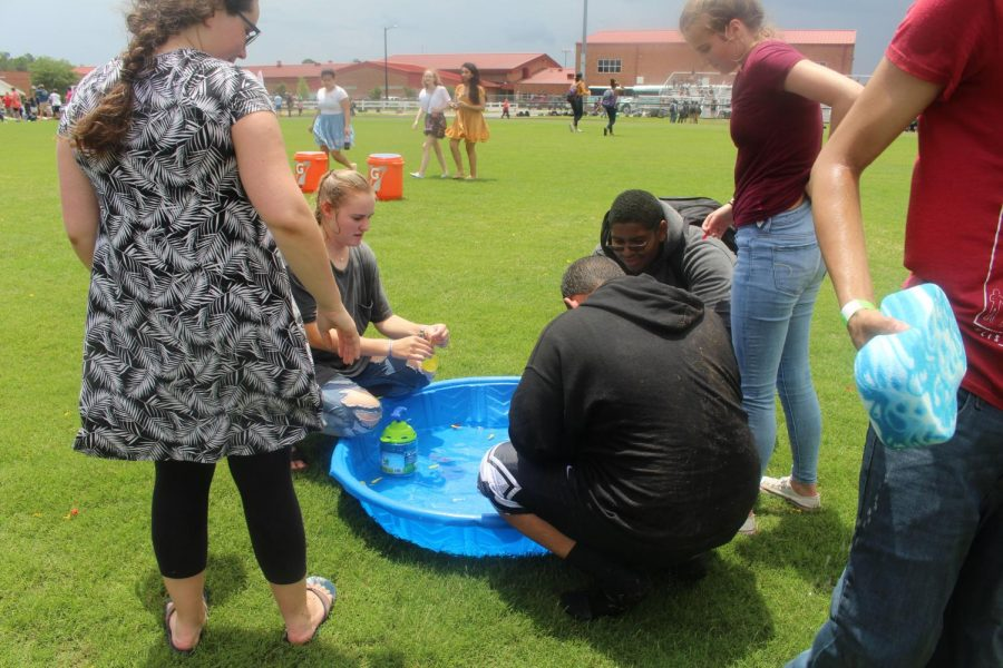 Students participate in water games.
