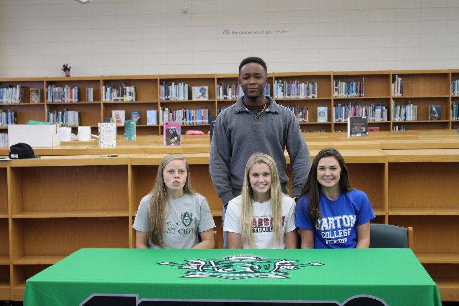 From left to right: Katelyn Fulford, Morgan Beeler, Savannah Branch, and Dylan Jeffries pictured in the back. All athletes committed to Division II and Division III schools.