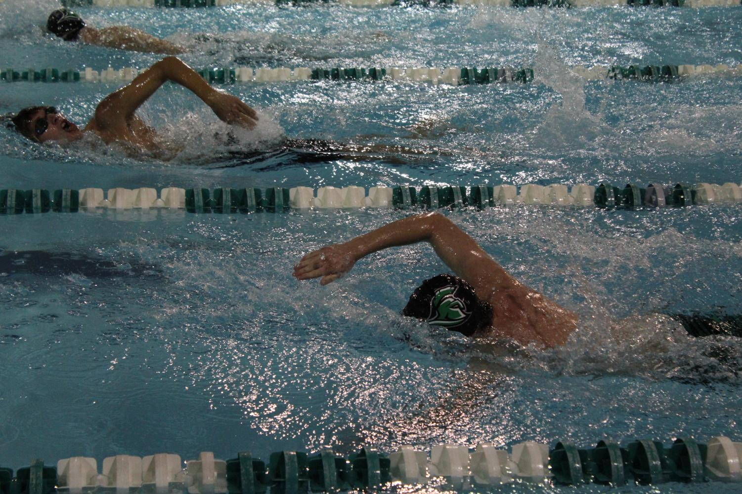 A Trojan swimmer working hard to place in their event.