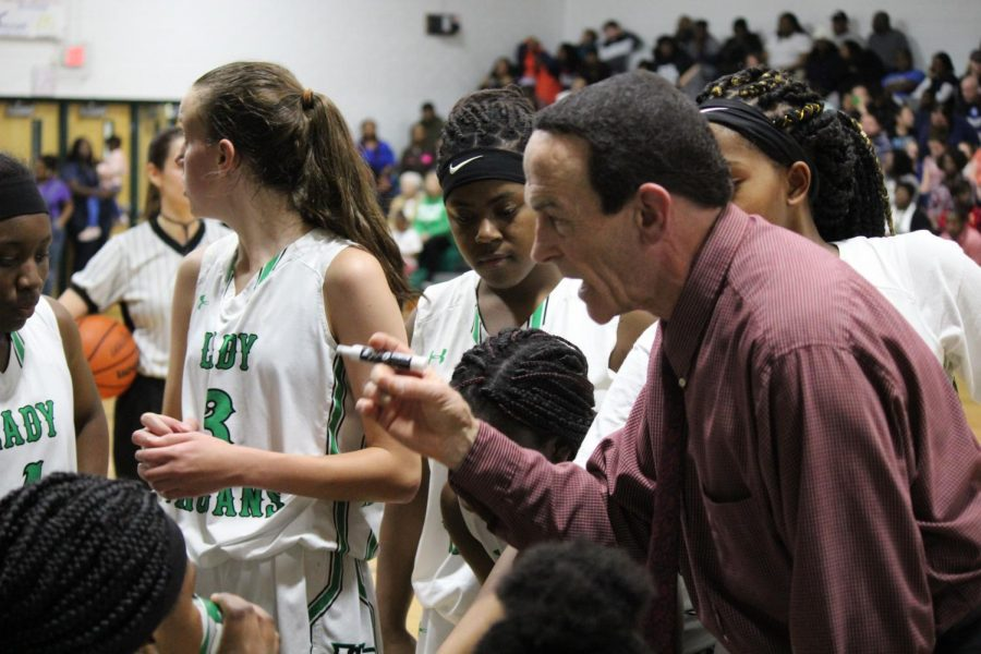Coach Lewkowicz coaches the team following them gaining the lead over NBHS.