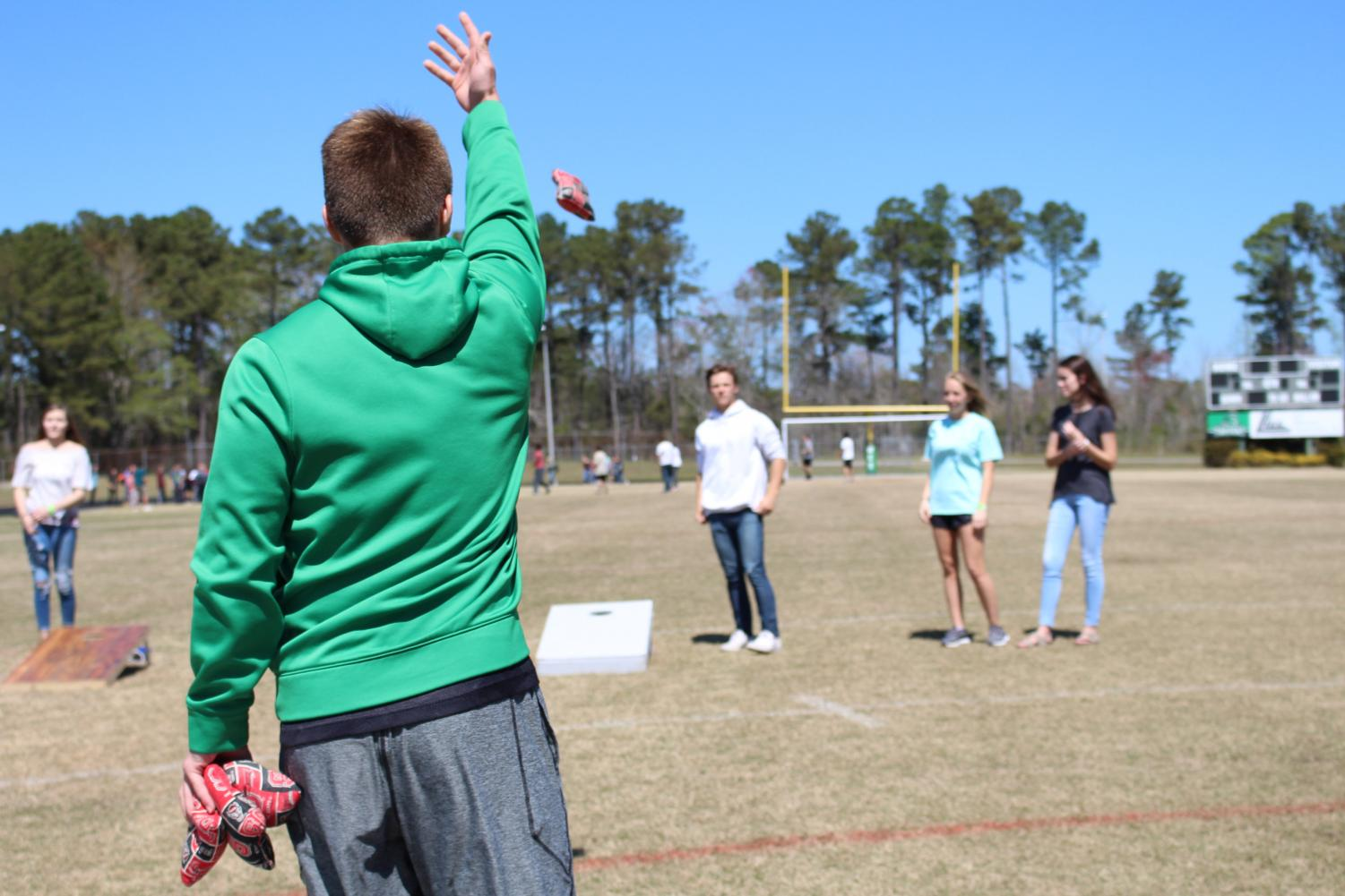 Jay Fletcher defeating his fellow students in corn hole.