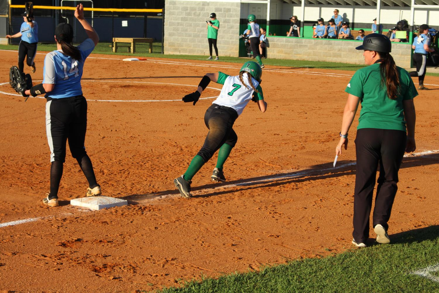 Number 7, Katelyn Fulford, running to home base.