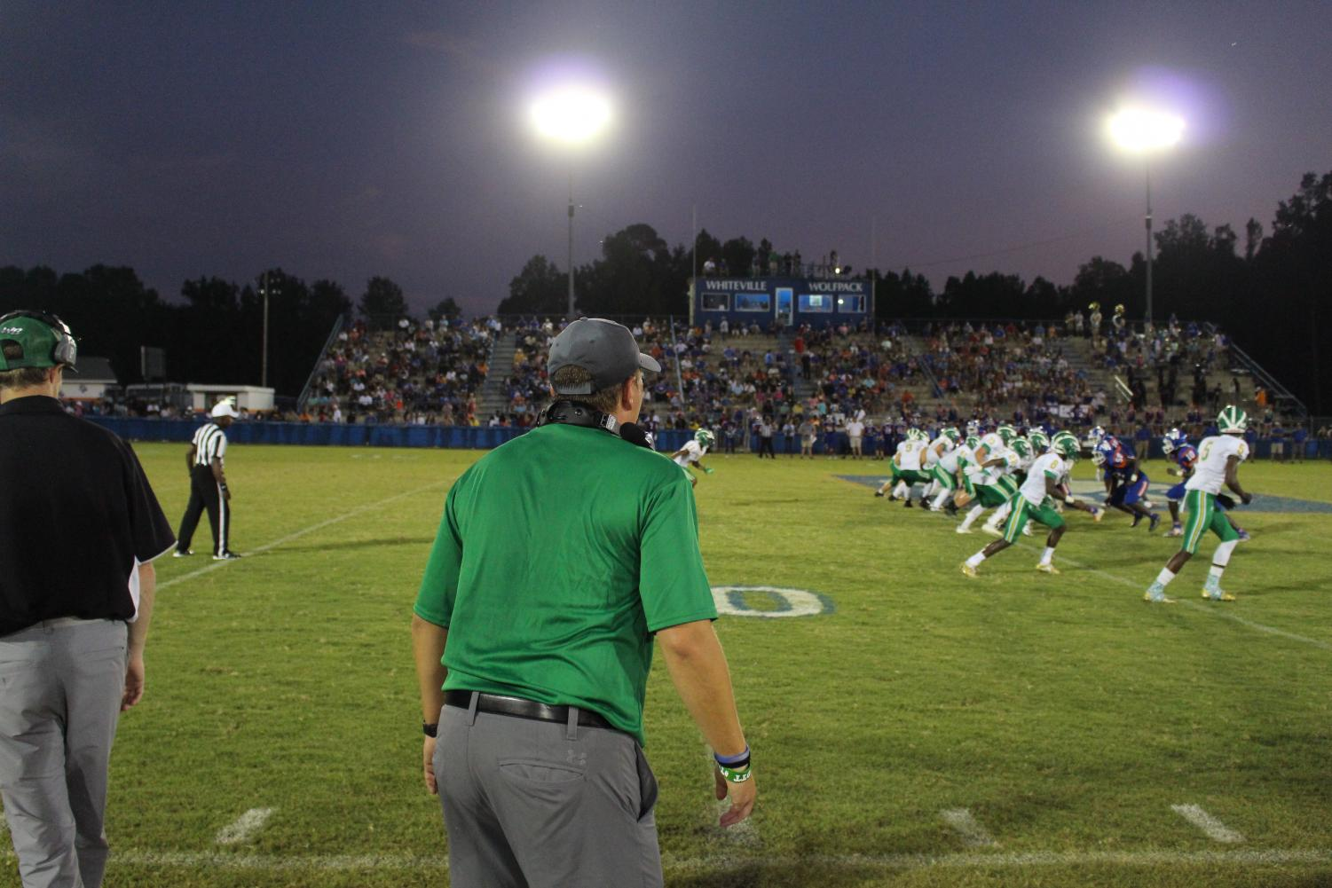Coach+Hickman+yells+onto+the+field+as+the+trojans+are+on+offense