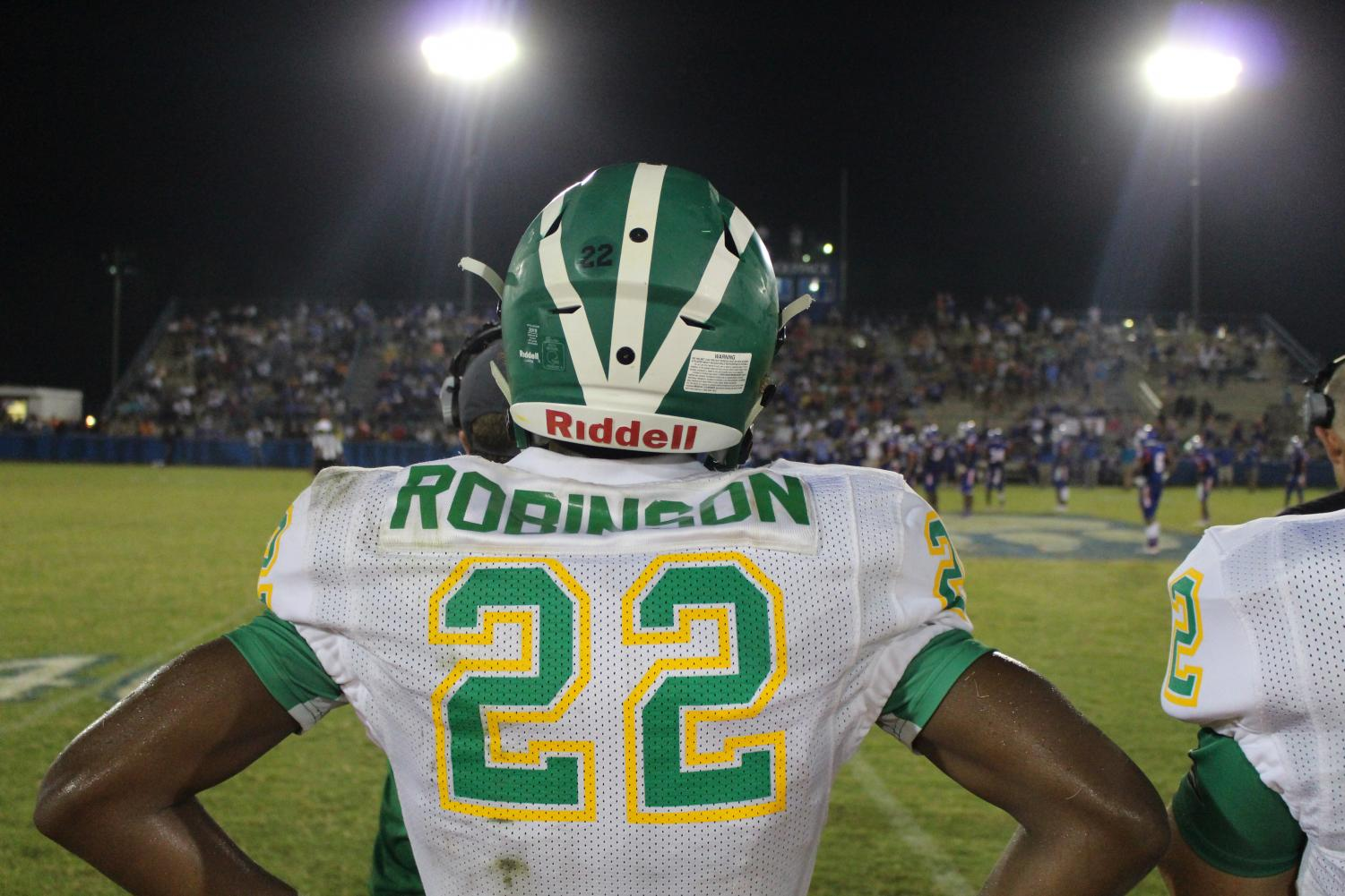 True+Robinson+stands+proudly+as+he+cheers+on+his+fellow+teammates.