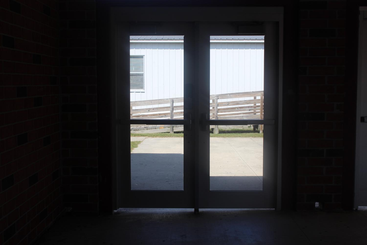 A capture of the locked doors to an entrance to a school.