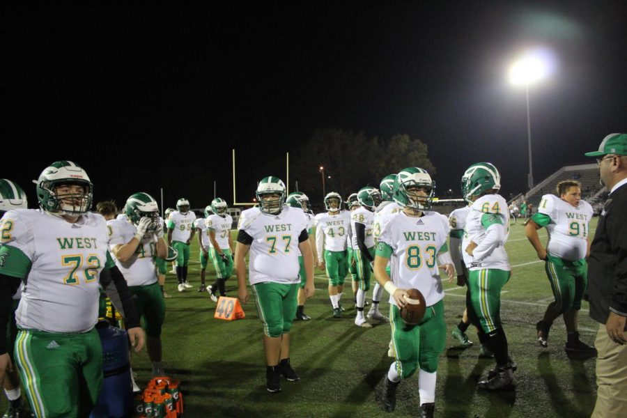 The Trojans walk to the locker rooms for halftime.