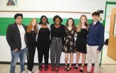 Juniors William Lopez, Jackie Hubbard, Tajah McCray, Aniah Metts, Alexis Dombroski, Casey Pardue, and Cole Hamilton dress up for a presentation in their American History class.