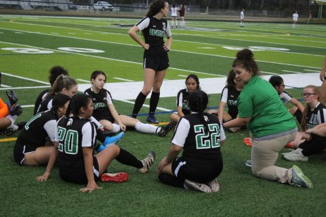 Coach Leonard gives the team a pep talk during half time