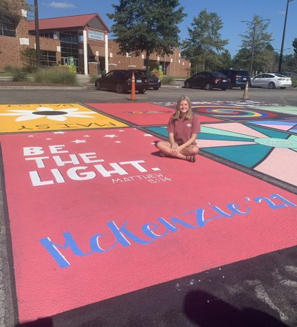 Senior Mckenzie Pope finishes up her parking spot.