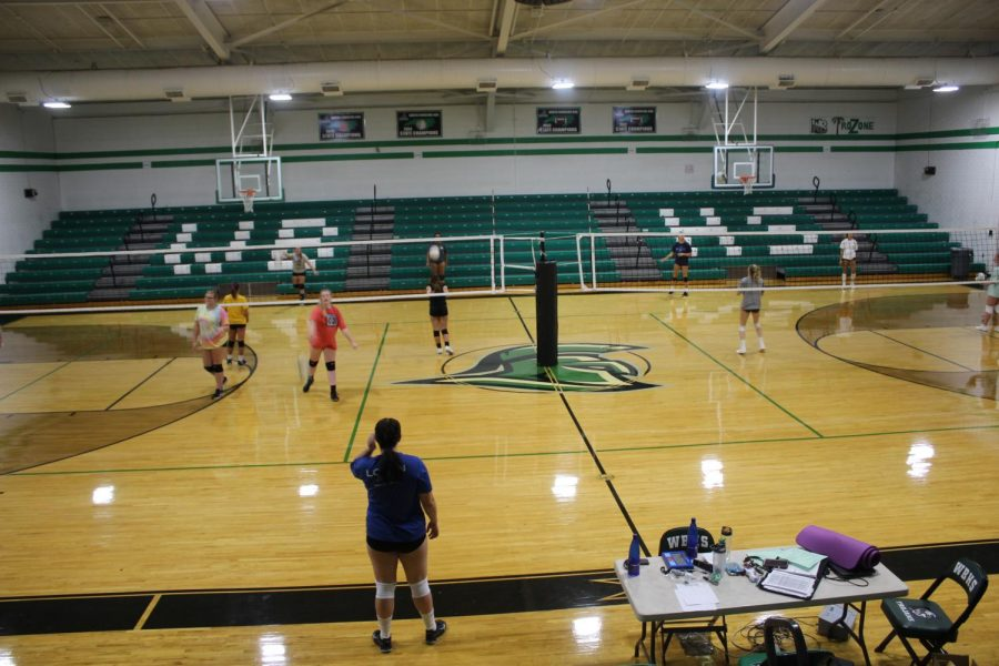 Girls from the JV and Varsity volleyball teams practiced in the main gym for their first day of workouts.