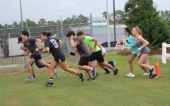 All Cross Country members taking off as they start their run.