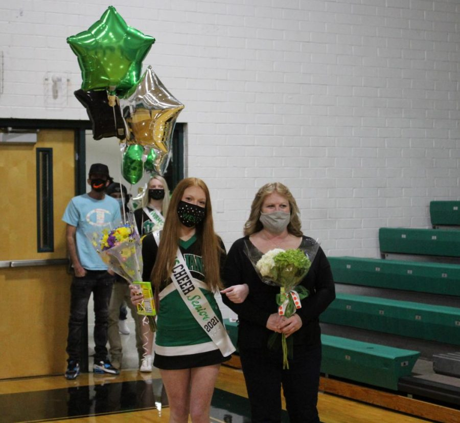 Senior cheerleader Jackie Hubbard poses for a picture.