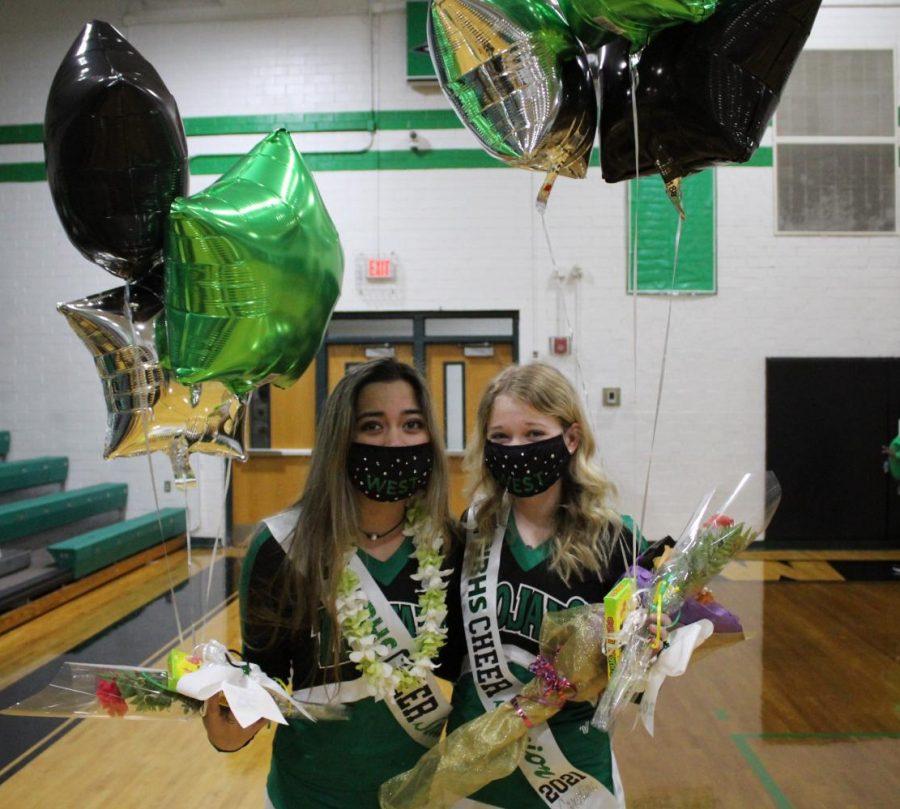 Senior cheerleaders Caroline Bryant and Lily Wells after senior night ceremony.