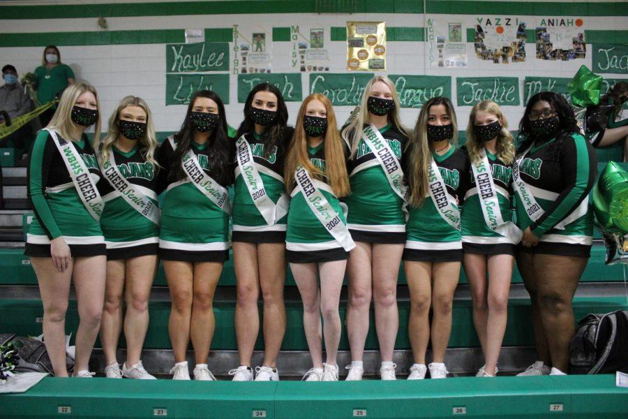 Senior cheerleaders after senior night ceremony.