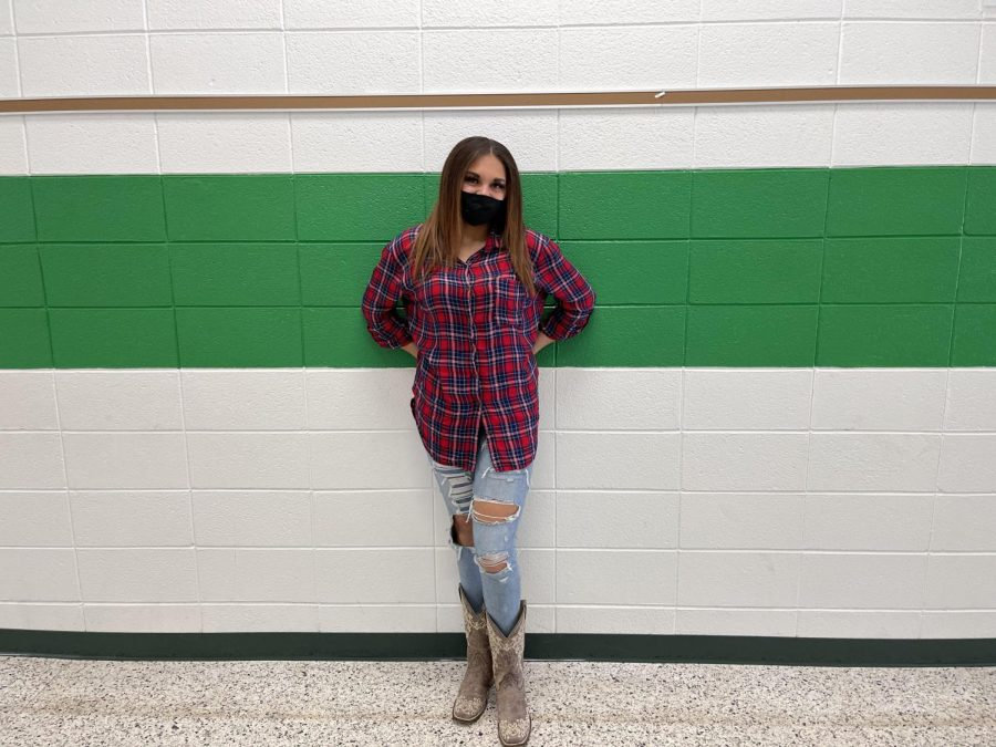 Sophmore Kyndel Johnson dresses up as a cowgirl for spirit week.