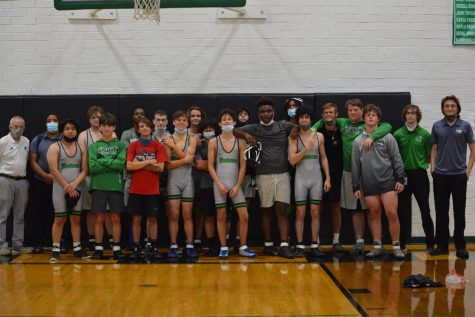 Trojans wrestling team posing for a group picture.