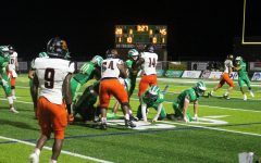 The West Brunswick Trojans defend the Wallace-Rose Hill Bulldogs.