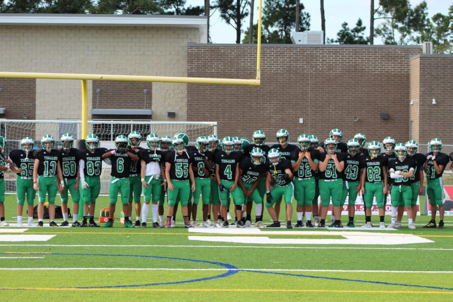 The Trojans JV Football Team poses for a photo before the game.
