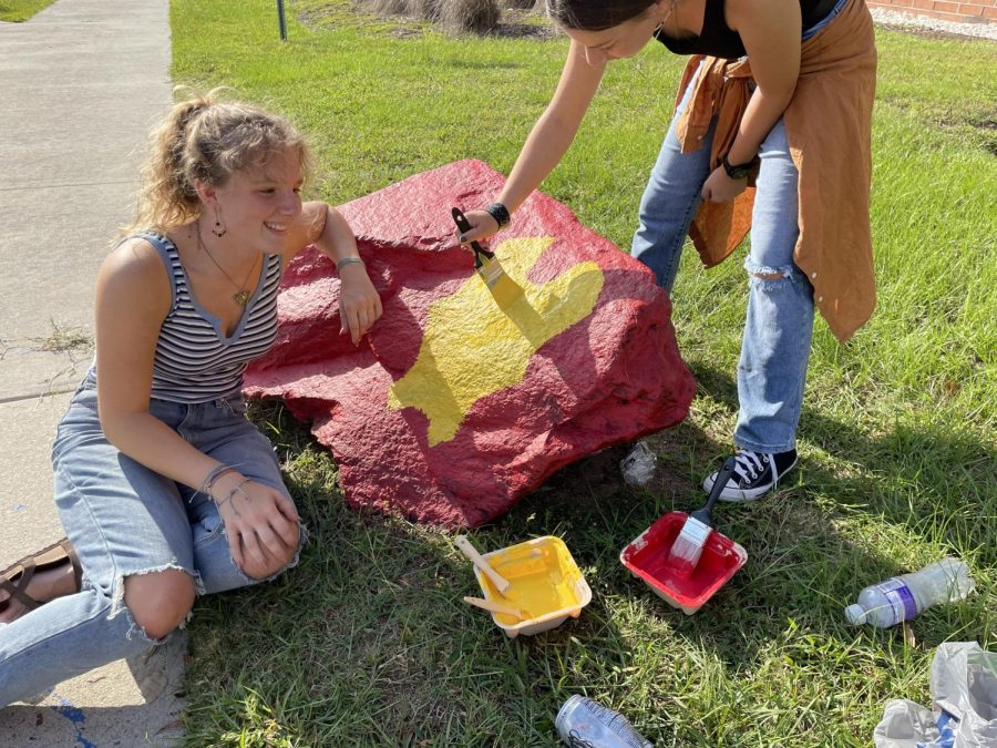 Students painting the senior class rock.